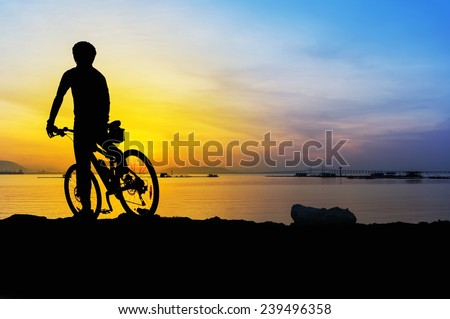 Great sunrise with silhouette mountain bike cyclist