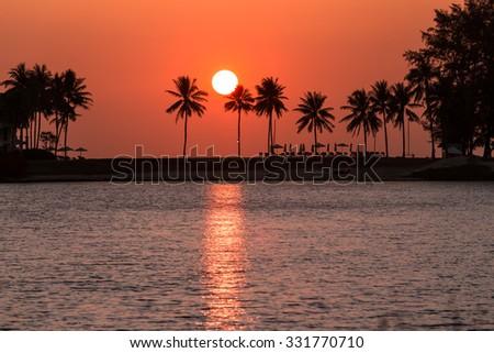 Great sunset seen from Laguna Phuket - stock photo