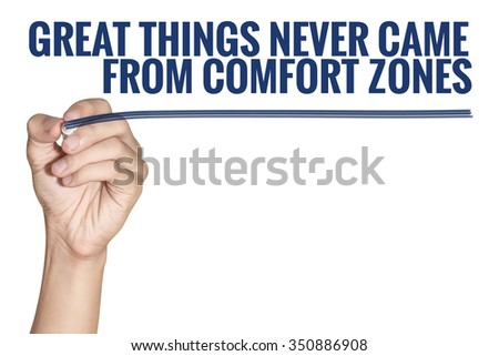 Great Things Never Came From Comfort Zones word written by man hand holding blue highlighter pen with line on white background - stock photo