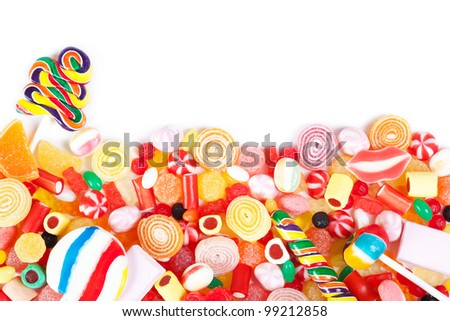 Great variety of colorful candy with white copyspace - stock photo