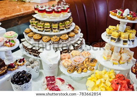 Great variety of different multicolored snacks on the wedding buffet.