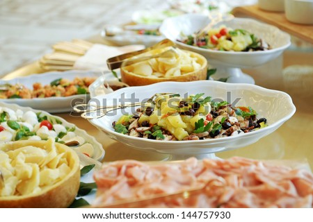 Great variety of salads on a buffet table - stock photo