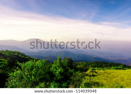 Great view of the foggy Beautiful landscape on mountain with nice sky in sunset .