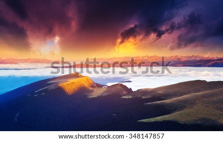 Great view of the foggy Gardena valley. National Park Odle (Geisler). Dolomites, South Tyrol. Location Ortisei. Italy, Europe. Dramatic scene. Beauty world.