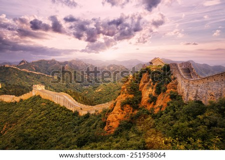 great wall and skyline during sunset - stock photo