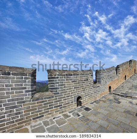 Great Wall China with a dramatic blue sky