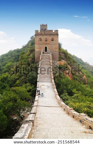 Great wall of China with a worker repairing on site - stock photo