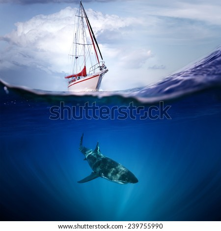 Great white shark under wave and white yacht above - stock photo