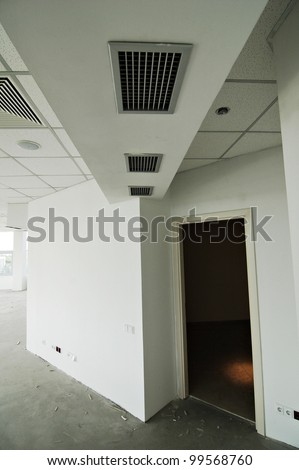Greater room of modern under construction office. Useful file for your brochure or flyer about your new started business. - stock photo