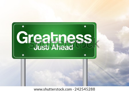 Greatness, Just Ahead Green Road Sign, business concept - stock photo