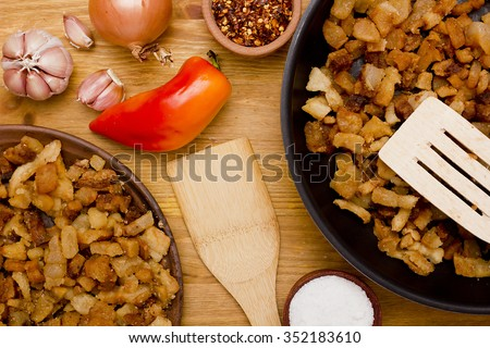 Greaves of fat obtained by rendering lard. - stock photo