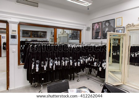 GREECE - APR 22, 2016: Fur coat shop at the factory of Papandopulos in Kastoria, Greece. Very populat brand of Greek made fir coats