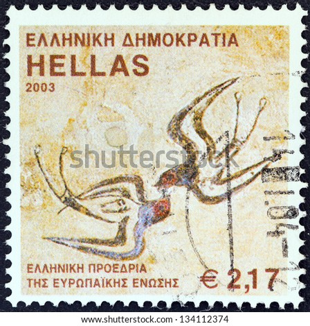 "GREECE - CIRCA 2003: A stamp printed in Greece from the ""EU Greek Presidency"" issue shows ""The Spring Fresco"", Santorini island, circa 2003. - stock photo"
