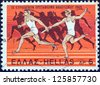 """GREECE - CIRCA 1969: A stamp printed in Greece from the """"9th European Athletic Championships, Athens"""" issue shows relay racing, and Olympic race from 525 B.C., circa 1969. - stock photo"""