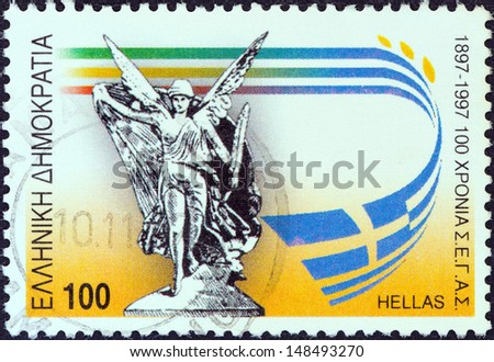 "GREECE - CIRCA 1997: A stamp printed in Greece from the ""6th World Athletics Championships, Athens"" issue shows Nike (statue), circa 1997.  - stock photo"