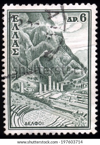 "GREECE - CIRCA 1961: A stamp printed in Greece from the ""Tourist Publicity"" issue shows the archaeological site of Delphi, circa 1961.  - stock photo"