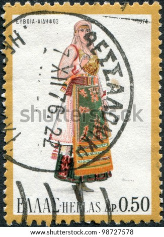 GREECE - CIRCA 1974: A stamp printed in Greece, shows a woman in national dress of the region Aidipsos, circa 1974 - stock photo