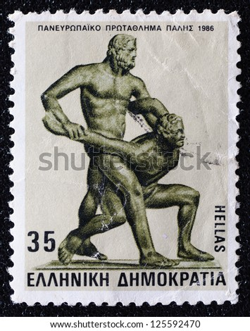 "GREECE - CIRCA 1986: A stamp printed in Greece shows ancient sport ""Wrestling"" , circa 1986. - stock photo"