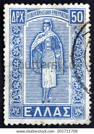 GREECE - CIRCA 1947: a stamp printed in the Greece shows Dodecanese Costume, circa 1947 - stock photo