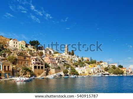 Greece. Dodecanesse. Island Symi Simi . Colorful houses on the rocks