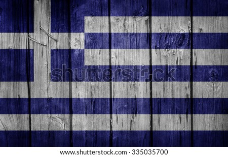 Greece flag painted on old wooden wall