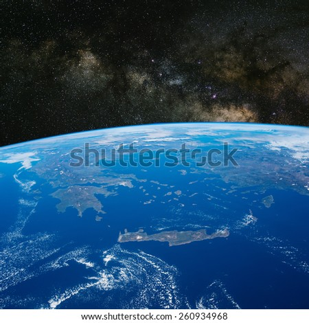 Greece from space with the Milky Way above. Elements of this image furnished by NASA.  - stock photo