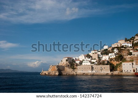 Greece, island and city of Paros. View of the cape and beacon. - stock photo