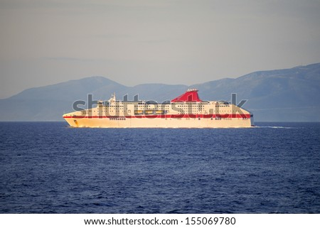 Greece ithaki,cruise ship traveling in open sea in mediterranean at a summer day