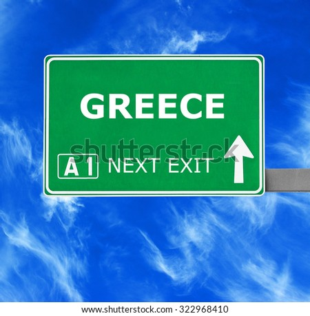 GREECE road sign against clear blue sky