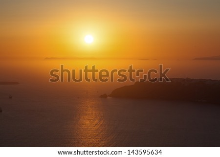 Greece santorini island in cyclades,the most famous sunset of the world above caldera view over sea - stock photo