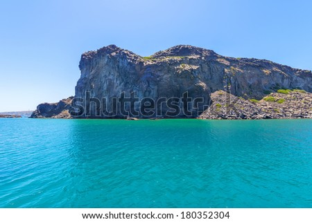 Greece Santorini island wide angle seascape view of colorful sea of caldera at the volcano   at summer during daylight - stock photo