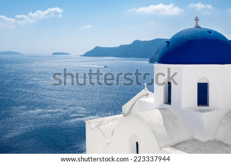 GREECE, SANTORINI- OCT 3: The greek church in the Oia village, sea view. October 3, 2014 - stock photo