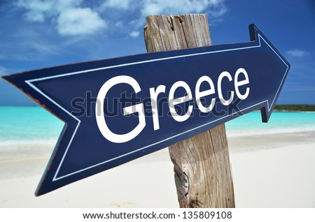 GREECE sign on the beach - stock photo
