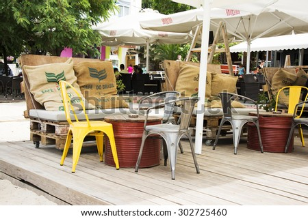 "Greece,Thassos island, Potos, June 30,2015: Exterior of a beach cafe bar ""Anonymo""with colorful and beautifl designed tables and chairs from recycled and ecology materials in Potos on Thassos island."