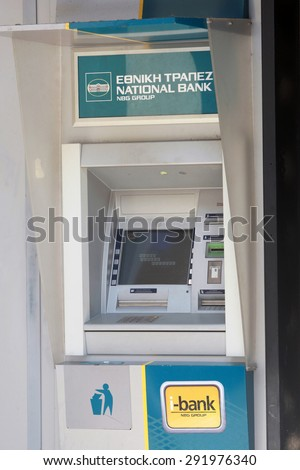 GREECE, Thessaloniki JUNE 29, 2015:  An automated teller machine (ATM) outside a closed national bank. Greek banks will stay closed for six days, and capital controls will be imposed when they reopen. - stock photo