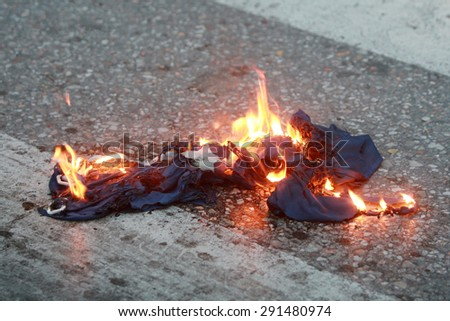 GREECE, Thessaloniki JUNE 28, 2015: Greek crisis. Members of various left wing parties burn a EU flag during a protest calling for Greeks to vote NO to Sunday's referendum and exit the European Union - stock photo