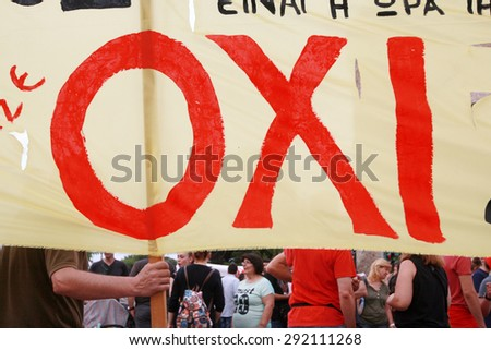 GREECE, Thessaloniki JUNE 29, 2015: Greek crisis. Pro-government supporters of the NO vote in the upcoming referendum protest holding banners reading NO (OXI in greek) during a rally in Thessaloniki - stock photo