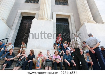GREECE, Thessaloniki JUNE 29, 2015: Greek debt crisis. Elderly people wait outside a closed national bank in Thessaloniki hoping to take their pensions. - stock photo