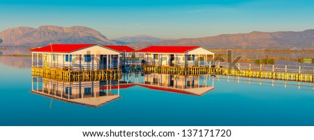 Greece, traditional house in lake by Mountains at Winter time, Tourlida central Greece ideal for summer vacations with beautiful landscapes  - stock photo