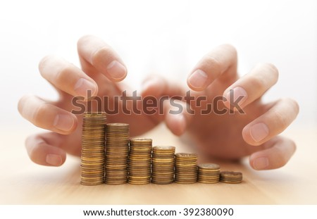 Greed for money. Hands grabbing coins.  - stock photo