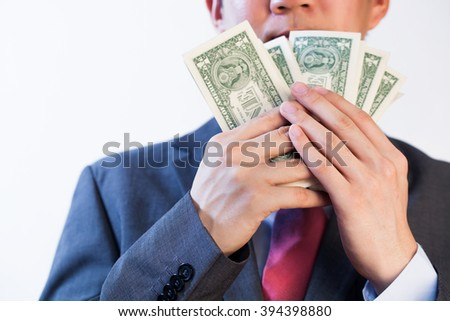 Greedy Business man showing off his money - stock photo
