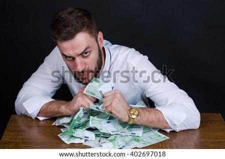 greedy man - stock photo
