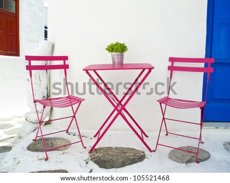 Greek breakfast table and chairs - stock photo
