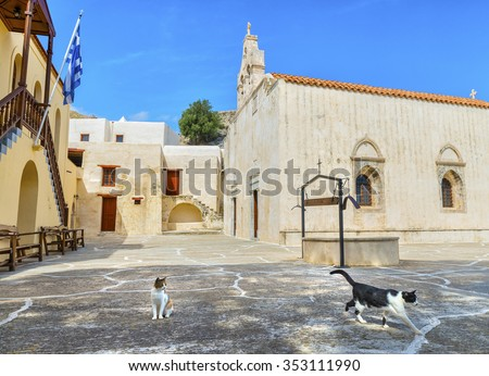 Greek cats near with beautiful orthodox temple in the Patriarchal Monastery of Saint John the Theologian, known as the Monastery of Preveli.District of Rethymno.Crete island.Greece.Europe. - stock photo