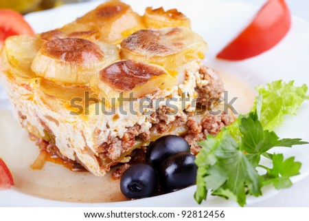 Greek cuisine. Moussaka - casserole of minced meat and vegetables - stock photo