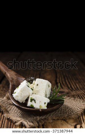 Greek Feta Cheese on rustic wooden background (close-up shot) - stock photo