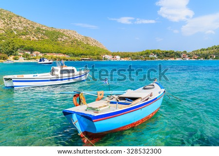 Greek fishing boats on turquoise sea water in Posidonio bay, Samos island, Greece - stock photo