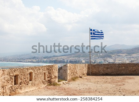 Greek Flag at the Venetian Fortezza or Citadel in the city of Rethymno on the island of Crete, Greece, created in 1573. - stock photo