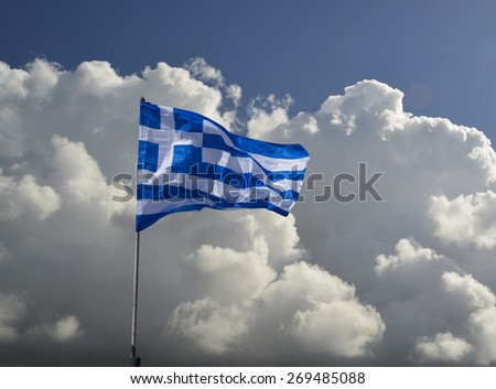 greek flag crisis heavy clouds - stock photo