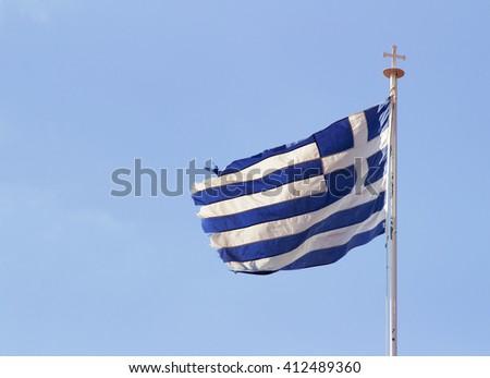 Greek flag on Orthodox Monastery. Cyprus. - stock photo